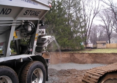 Ultra Stone Slinger placing stone in a basement excavation