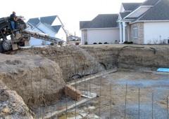 Ultra Stone Slinger placing stone for basement slab